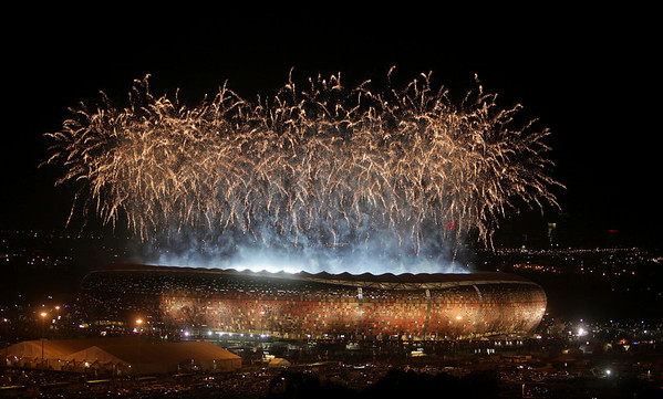 Fireworks are set off above Johannesburg's Soccer City Stadium after Spain beat Netherlands in the final match of the World Cup Soccer Tournament Sunday, July 11, 2010. (AP Photo/Denis Farrell)