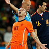 South Africa Soccer WCup Fi.JPG Referee Howard Webb of England, center, gestures as Netherlands' Wesley Sneijder, left, reacts to his decision during the World Cup final soccer match between the Netherlands and Spain at Soccer City in Johannesburg, South Africa, Sunday, July 11, 2010.  (AP Photo/Bernat Armangue)