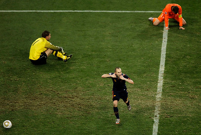 Spain's Andres Iniesta, center, celebrates after scoring the decisive  goal past Netherlands goalkeeper Maarten Stekelenburg, left, during the World Cup final soccer match between the Netherlands and Spain at Soccer City in Johannesburg, South Africa, Sunday, July 11, 2010.  (AP Photo/Hassan Ammar)
