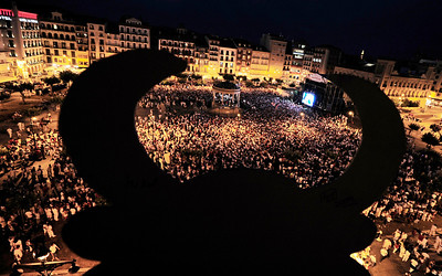 A cutout of a bull overlooks Pamplona's Plaza del Castillo as San Fermin revelers watch a live broadcast of the World Cup soccer final between Spain and the Netherlands, which is being played in South Africa, on Sunday, July 11, 2010. (AP Photo/Alvaro Barrientos)