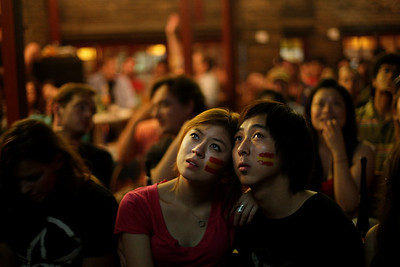 China WCup Soccer.JPEG-00b1.JPG A Chinese couple watches the final match of the World Cup between Spain and the Netherlands being played in South Africa, in Beijing, China, early Monday, July 12, 2010. Spain defeated the Netherlands 1-0. (AP Photo/Muhammed Muheisen)
