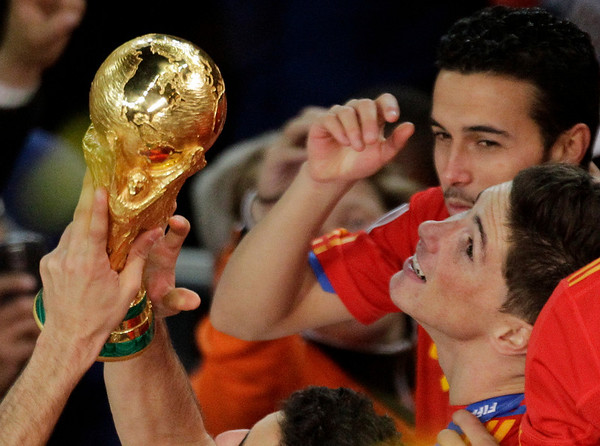 Spain's Fernando Torres celebrates with teammates holding the World Cup trophy at the end of the World Cup final soccer match between the Netherlands and Spain at Soccer City in Johannesburg, South Africa, Sunday, July 11, 2010. Spain won 1-0.  (AP Photo/Themba Hadebe)