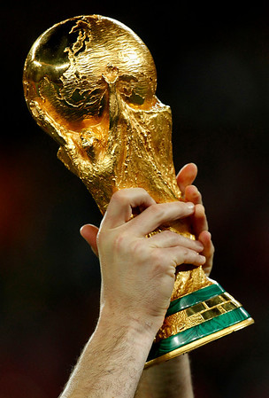 Spain goalkeeper Iker Casillas holds up the World Cup trophy after the World Cup final soccer match between the Netherlands and Spain at Soccer City in Johannesburg, South Africa, Sunday, July 11, 2010. Spain won 1-0.  (AP Photo/Bernat Armangue)