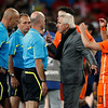 Netherlands head coach Bert van Marwijk, second from right, speaks with referee Howard Webb of England, third left, following the World Cup final soccer match between the Netherlands and Spain at Soccer City in Johannesburg, South Africa, Sunday, July 11, 2010.  (AP Photo/Luca Bruno)