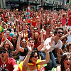 Fans watching the television broadcast of the World Cup final in Vancouver, British Columbia, on Sunday, July 11, 2010, celebrate after Spain scored against the Netherlands. A street was closed to vehicles and people filled a full city block to watch the game. (AP Photo/The Canadian Press, Darryl Dyck)