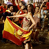 Spanish fans celebrate in a fountain in downtown Madrid after Spain defeated the Netherlands to win the World Cup soccer final, which is being played in South Africa, on Sunday, July 11, 2010. Spain won 1-0.(AP Photo/Paul White)