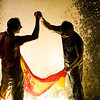 Fans celebrate with a Spanish flag in a fountain at Barcelona's Plaza Espana after Spain's defeated the Netherlands 1-0 to win the World Cup soccer final, which is being played in South Africa, on Sunday, July 11, 2010.(AP Photo/David Ramos)
