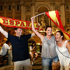 Spanish soccer fans celebrate in front of Rome's Trevi fountain after Spain defeated the Netherlands to win the World Cup soccer final, played in South Africa, Sunday, July 11, 2010. Spain won 1-0. (AP Photo/Pier Paolo Cito)