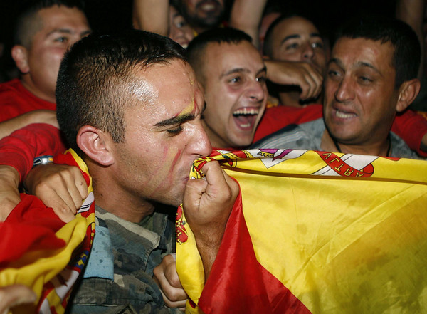 Spanish soldiers serving with the United Nations Interim Force in Lebanon (UNIFIL) celebrate after Spain defeated the Netherlands 1-0 to win the World Cup soccer final, played in South Africa, at their base in the village of Blatt, near the southern town of Marjayoun, Lebanon, Sunday, July 11, 2010. (AP Photo/Lutfallah Daher)