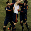 Spain's Andres Iniesta, center, celebrates with Spain's Fernando Torres, left, and Spain's David Villa, right, after scoring the decisive goal during the World Cup final soccer match between the Netherlands and Spain at Soccer City in Johannesburg, South Africa, Sunday, July 11, 2010.  (AP Photo/Hassan Ammar)