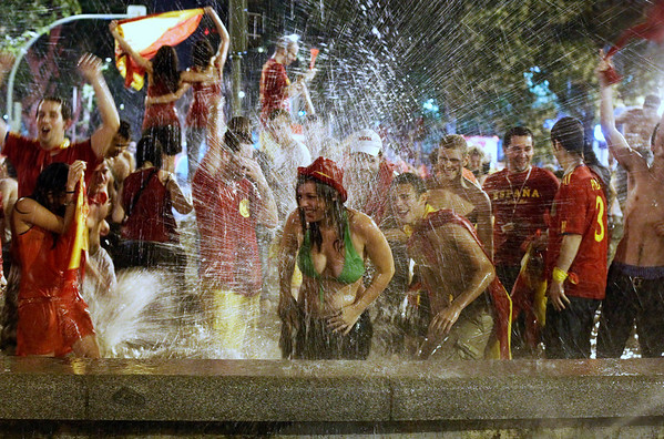Spanish fans celebrate in a fountain in downtown Madrid after Spain defeated the Netherlands to win the World Cup soccer final, played in South Africa, on Sunday, July 11, 2010. Spain won 1-0.(AP Photo/Paul White)