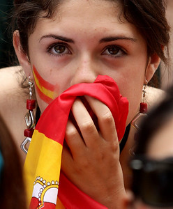 APTOPIX World Cup Watching.JPG A Spanish fan holds a flag against her face as she watches on an outdoor screen in Vancouver, British Columbia, on Sunday, July 11, 2010, as Spain and the Netherlands play in the World Cup soccer final. A street was closed to vehicles and people filled a full city block to watch the game, which Spain won 1-0. (AP Photo/The Canadian Press, Darryl Dyck)