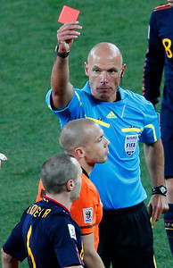 South Africa Soccer WCu(11).JPG Referee Howard Webb of England, right, shows the red card to Netherlands' John Heitinga, center, during the World Cup final soccer match between the Netherlands and Spain at Soccer City in Johannesburg, South Africa, Sunday, July 11, 2010.  (AP Photo/Eugene Hoshiko)