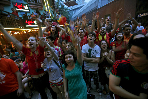 China WCup Soccer.JPEG-036f.JPG Fans celebrate in Beijing, China, after Spain defeated the Netherlands 1-0 to win the World Cup soccer final, played in South Africa, early Monday, July 12, 2010. (AP Photo/Muhammed Muheisen)