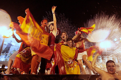 Spanish fans celebrate in a fountain in downtown Madrid after Spain defeated the Netherlands to win the World Cup soccer final, taking place in South Africa, on Sunday, July 11, 2010. Spain won 1-0. (AP Photo/Arturo Rodriguez)