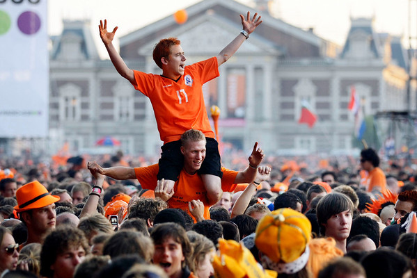 Fans of the Dutch soccer team watch the World Cup soccer final match between Netherlands and Spain in Amsterdam, Netherlands, Sunday, July 11, 2010.  Spain defeated the Dutch with a 1-0 score in extra time. (AP Photo/Vincent Jannink)