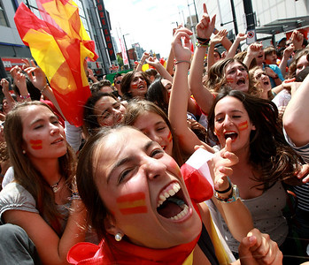 Bea Monzo, center, of Spain, and other fans watching the broadcast in Vancouver, British Columbia, of the World Cup soccer final on Sunday, July 11, 2010, celebrate after Spain defeated the Netherlands. A street was closed to vehicles and people filled a full city block to watch the game. (AP Photo/The Canadian Press, Darryl Dyck)