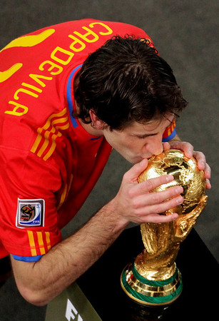 Spain's Joan Capdevila kisses the World Cup trophy after the World Cup final soccer match between the Netherlands and Spain at Soccer City in Johannesburg, South Africa, Sunday, July 11, 2010. Spain won 1-0. (AP Photo/Themba Hadebe)