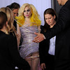Lady Gaga, center, arrives at the Grammy Awards on Sunday, Jan. 31, 2010, in Los Angeles. (AP Photo/Chris Pizzello)