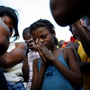 A girl prays  during a religious service in Port-au-Prince on Monday, Feb. 1, 2010. A 7.0-magnitude earthquake hit Haiti on Jan. 12 leaving thousands dead and many displaced. (AP Photo/Rodrigo Abd)