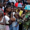 U.N. peacekeepers, from Nepal help to organize the lines of earthquake survivors during a food distribution in Petionville, Haiti, on Monday, Feb. 1, 2010. A 7.0-magnitude earthquake hit Haiti on Jan. 12 leaving thousands dead and many displaced. (AP Photo/Andres Leighton)