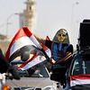 An Egypian soccer fan wears a Pharaonic mask and waves an Egyptian flag while celebrating the arrival of Egyptian national soccer team in Cairo, Egypt, on Monday, Feb. 1, 2010, after winning the African Cup of Nations soccer tournament, played in Ghana. ( AP Photo/Amr Nabil)