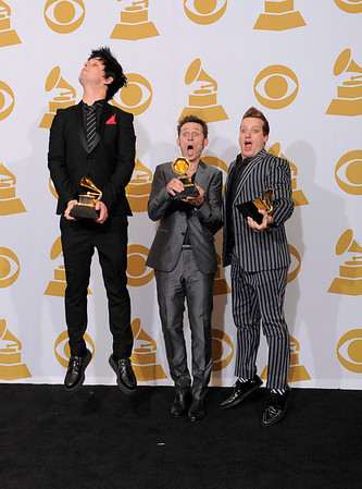 """From left, Billie Joe Armstrong, Mike Dirnt and Tré Cool of Green Day hold best rock album award for """"21st Centruy Breakdown,"""" backstage at the Grammy Awards on Sunday, Jan. 31, 2010, in Los Angeles.  (AP Photo/Mark J. Terrill)"""