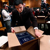 Senate staff member Sam Armocido unpacks copies of President Barack Obama's budget which was delivered to the Senate Budget Committee on Monday, Feb. 1, 2010, on Capitol  Hill in Washington.  (AP Photo/Manuel Balce Ceneta)