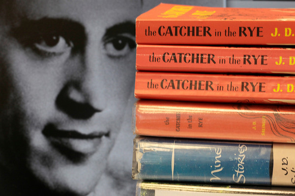 "Copies of J.D. Salinger's classic novel ""The Catcher in the Rye"" as well as his volume of short stories called ""Nine Stories"" are seen at the Orange Public Library in Orange Village, Ohio, on Thursday.  Salinger, the legendary author, youth hero and fugitive from fame whose ""The Catcher in the Rye"" shocked and inspired a world he increasingly shunned,  died Wednesday at the age of  91. At left is a 1951 photo of the author. (AP Photo/Amy Sancetta)"
