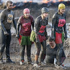 Competitors approach an obstacle during the Tough Guy Challenge, in South Perton Farm, in Staffordshire, England, on Sunday. Some thousands take part in the biannual assault course, and are challenged by 21 different obstacles, including, fire, tunnels, and swamps to complete the track. (AP Photo/Simon Dawson)