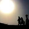 Pakistani villagers head out in search of water in Jafarabad, Pakistan, on Monday, Feb. 1, 2010. People are suffering from water shortage due to long dry spell. (AP Photo/Fida Baluch)