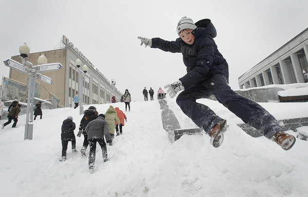 Children enjoy a slide on a little hill after a heavy snowfall in Minsk, Belarus, Monday, Feb. 1, 2010. (AP Photo/Sergei Grits)