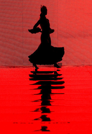 A model wears creations by Spanish designer Lourdes Bermejo during the International Flamenco Fashion Show in Seville, Spain, Thursday. (AP Photo/Miguel Angel Morenatti)