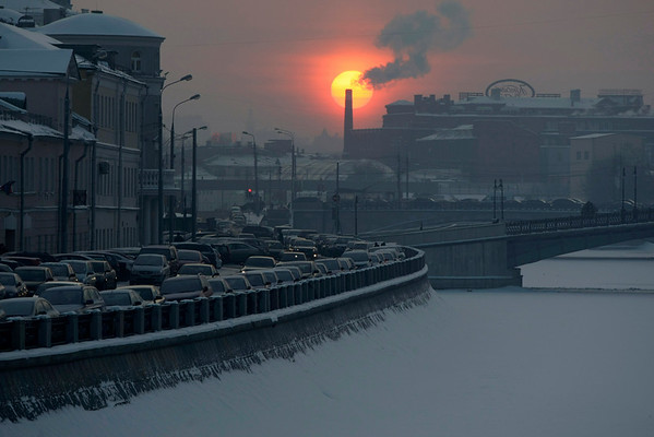 A winter sunset in downtown Moscow is seen Thursday. Weather experts said this month was the coldest in Moscow in sixty years. (AP Photo/Mikhail Metzel)