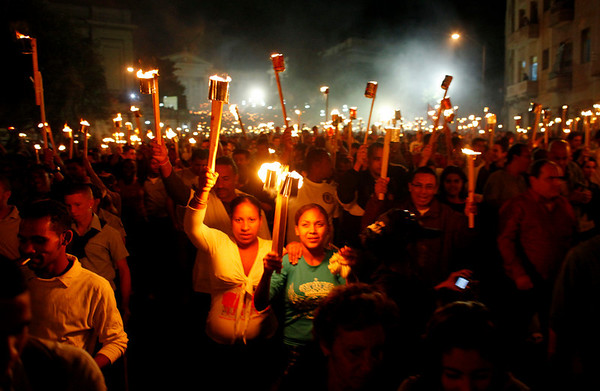 Hundreds of students hold torches during a late-night march to celebrate the 157th anniversary of the birth of Cuba's national independence hero, Jose Marti, at the entrance of the University of Havana, on Wednesday. (AP Photo/Javier Galeano)