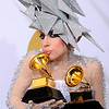 Musician Lady Gaga poses backstage with her awards for Best Dance Recording and Best Electronic Dance Album at the Grammy Awards on Sunday, Jan. 31, 2010, in Los Angeles.  (AP Photo/Matt Terrill)