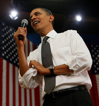 President Barack Obama rolls up his shirt sleeves at a town hall style meeting at the University of Tampa's Bob Martinez Sports Center in Tampa, Fla., on Thursday. (AP Photo/Charles Dharapak)