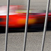 Ferrari Formula One driver Felipe Massa, of Brazil, in action through a security fence during a testing session at the Ricardo Tormo race track in Cheste, just outside Valencia, Spain, on Monday Feb,1, 2010. AP Photo/Paul White)