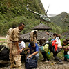 Tourists wait to be evacuated by helicopter from the Machu Picchu Pueblo archeological site in Cuzco, Peru, on Thursday. Heavy rains and mudslides in Peru have blocked the train route to the ancient Inca citadel of Machu Picchu, leaving nearly 2,000 tourists stranded. (AP Photo/Martin Mejia)