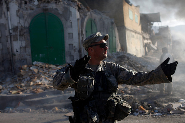A U.S. army soldier from the 82nd Airborne Division directs traffic while on patrol in Port-au-Prince, Haiti, on Thursday.  A 7.0-magnitude earthquake hit Haiti on Jan. 12, killing and injuring thousands and leaving many homeless.  (AP Photo/Rodrigo Abd)