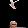 Pope Benedict XVI looks at white doves that were freed at the end of the Angelus prayer in St. Peter's square, at the Vatican, on Sunday, Jan. 31, 2010. (AP Photo/Gregorio Borgia)