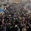 Shiite pilgrims file into the holy city of Karbala, Iraq, on Monday, Feb. 1, 2010, as faithful gather for Arbaeen, which marks the end of the forty-day mourning period after the anniversary of the 7th century martyrdom of Imam Hussein, the Prophet Muhammad's grandson. A female suicide bomber walking among Shiite pilgrims in Baghdad detonated an explosives belt on Monday, killing scores and wounding more than 100, officials said. The bombing was the first major strike this year against pilgrims making their way to the southern city of Karbala to mark a Shiite holy day. It came as security official warned of a possible increase in attacks by insurgents using new tactics to bypass bomb-detection methods. (AP Photo/Hadi Mizban)