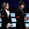 Michael Jackson's children Paris, left, and Prince Michael Jackson II accept the Lifetime Achievement award on behalf of their father at the Grammy Awards on Sunday, Jan. 31, 2010, in Los Angeles.  (AP Photo/Matt Sayles)