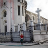 A woman prays in front of the cathedral, damaged  during the Jan. 12 earthquake that hit Haiti,  in Port-au-Prince, Sunday. (AP  Photo/ Rodrigo Abd)