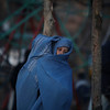 An Afghan woman holds her baby inside her burqa as she walks on a street in Kabul, Afghanistan, Monday, Feb. 1, 2010 (AP Photo/Altaf Qadri)