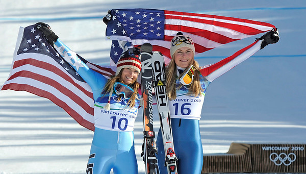 Lindsey Vonn of the United States, the gold medal winner, right, celebrates with her compatriot Julia Mancuso, silver,  during the flower ceremony for the Women's downhill at the Vancouver 2010 Olympics in Whistler, British Columbia, Wednesday, Feb. 17, 2010.  (AP Photo/Gero Breloer)