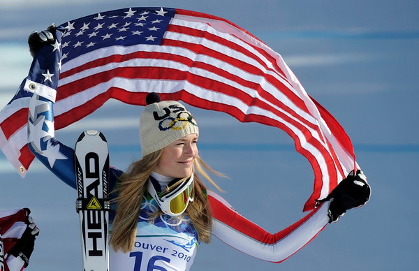 Lindsey Vonn of the United States, the gold medal winner  celebrates during the flower ceremony for the Women's downhill at the Vancouver 2010 Olympics in Whistler, British Columbia, Wednesday, Feb. 17, 2010.   (AP Photo/Gero Breloer)