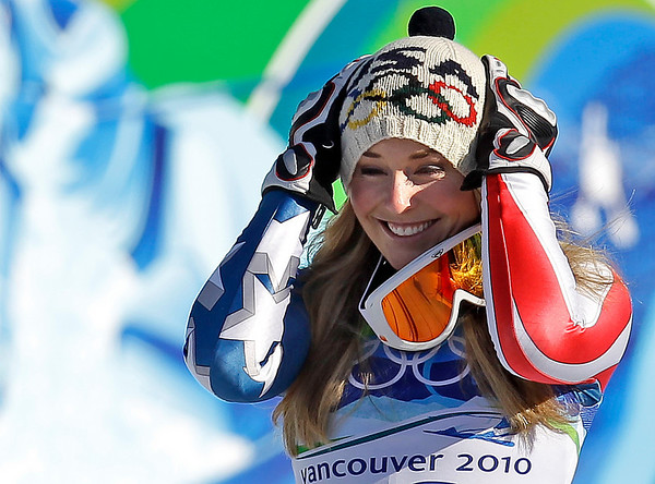 Lindsey Vonn of the United States, the gold medal winner  celebrates during the flower ceremony for the Women's downhill at the Vancouver 2010 Olympics in Whistler, British Columbia, Wednesday, Feb. 17, 2010.  (AP Photo/Sergey Ponomarev)