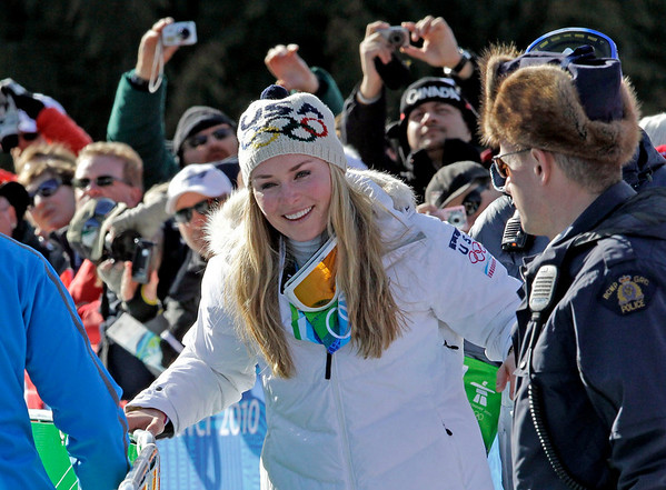 Lindsey Vonn of the United States reacts after finishing the Women's downhill at the Vancouver 2010 Olympics in Whistler, British Columbia, Wednesday, Feb. 17, 2010.   (AP Photo/Tom Curley)
