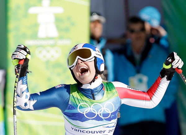 Lindsey Vonn, of the United States, reacts in the finish area after completing the Women's downhill at the Vancouver 2010 Olympics in Whistler, British Columbia, Wednesday, Feb. 17, 2010.  (AP Photo/Sergey Ponomarev)